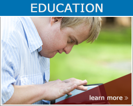 goal Education; Student with down syndrome playing on tablet