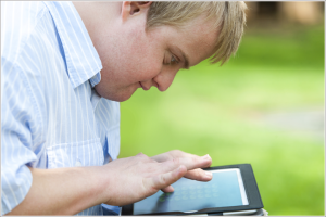 goal EDUCATION, student with down syndrome playing on tablet